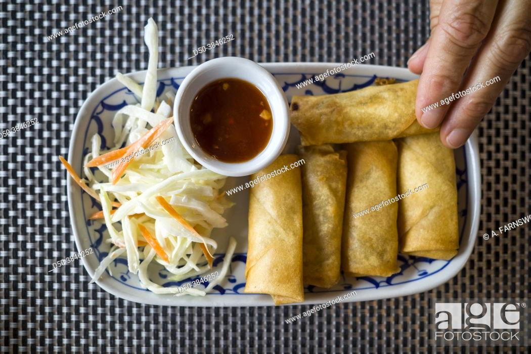 Stock Photo: Amal, Sweden Spring rolls and sauce in a Thai restaurant.