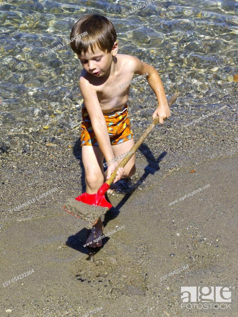 Stock Photo: children play with sand, italy, lombardy, lake maggiore.