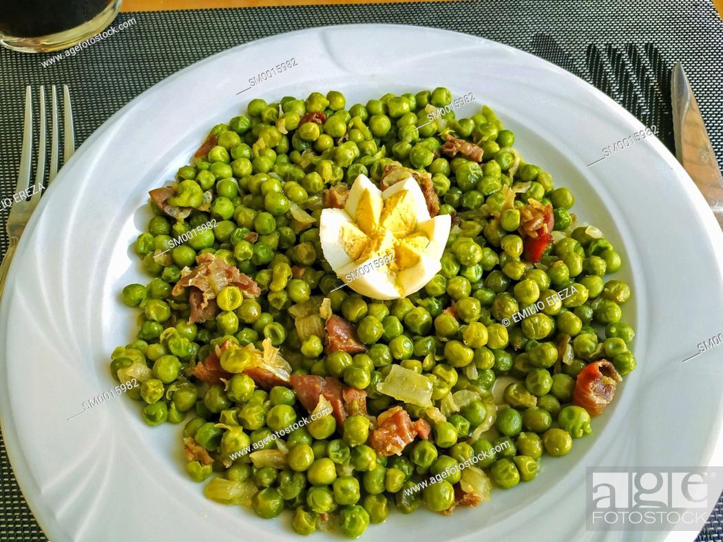 Stock Photo: Peas with ham.