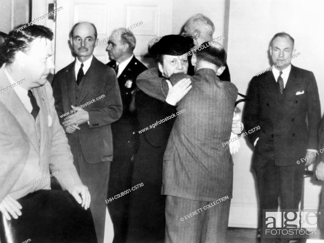 Stock Photo: Secretary of Labor Frances Perkins in grief over the President's Franklin Roosevelt's death. April 12, 1945. She embraces Isidor Lupin.