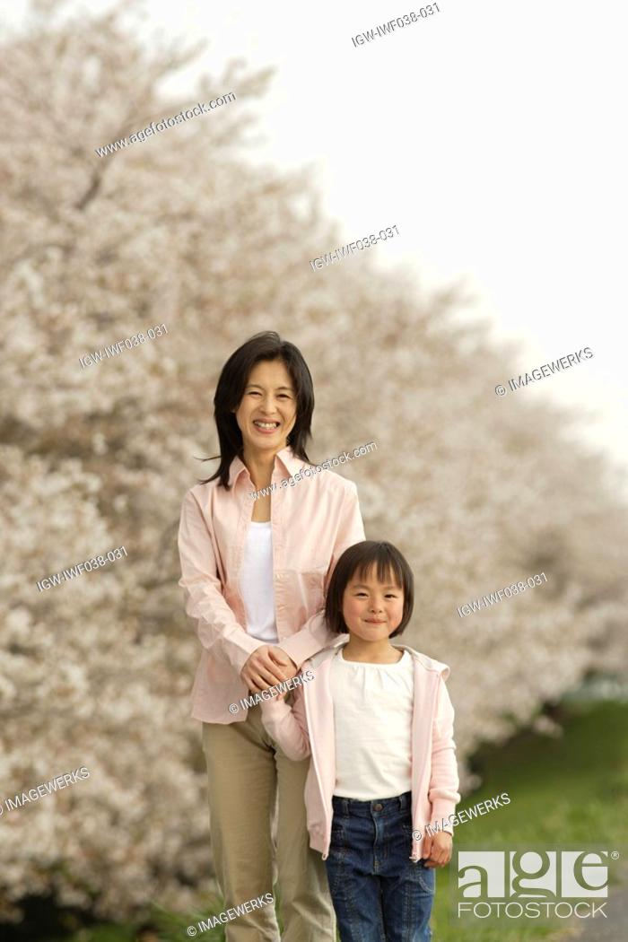 Stock Photo: Portrait of a mother and daughter holding hands.