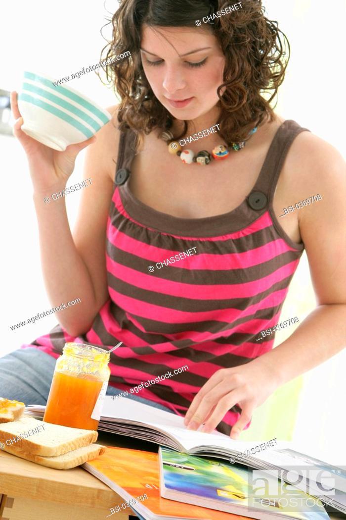 Stock Photo: ADOLESCENT EATING BREAKFAST Model.