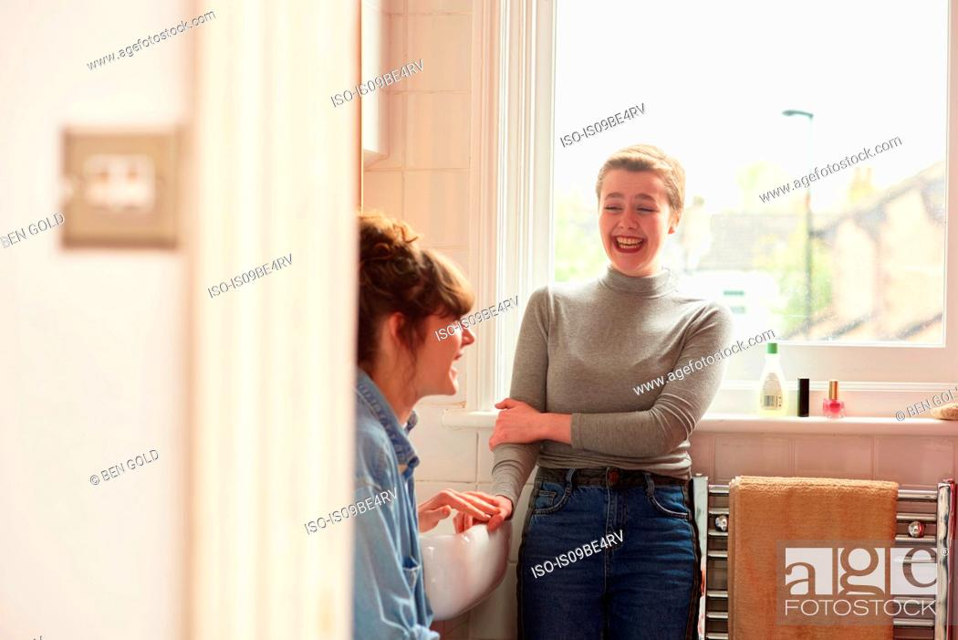 Stock Photo: Friends chatting in bathroom.