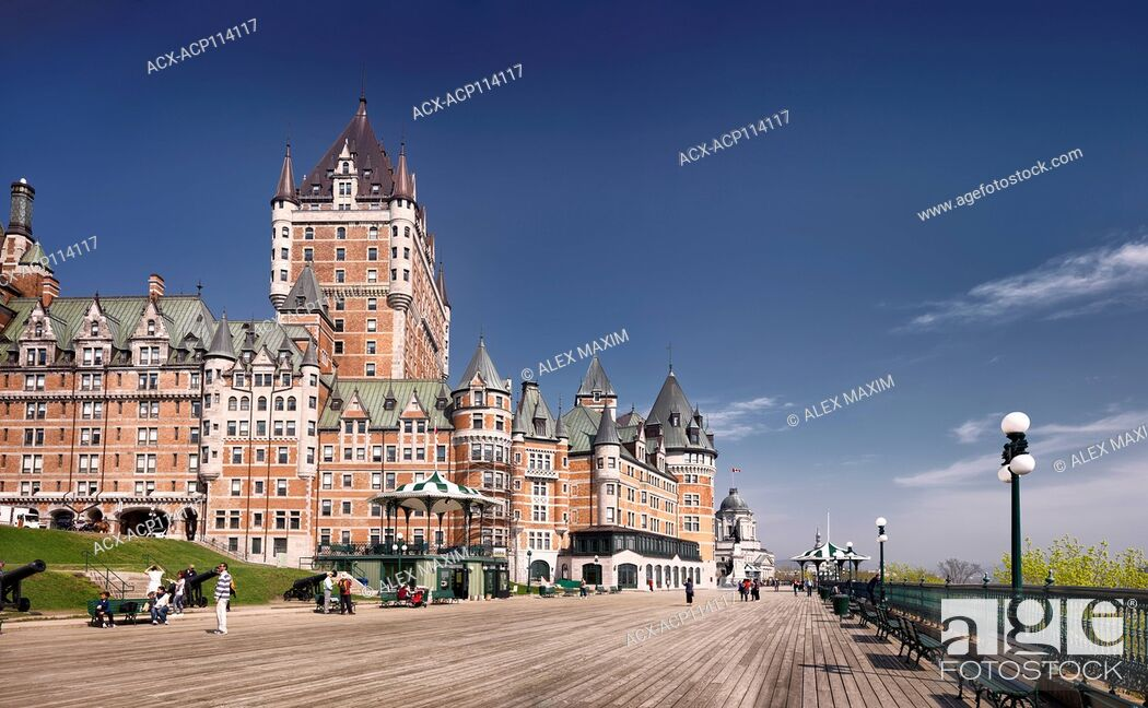 Stock Photo: Panoramic view of Fairmont Le Château Frontenac castle and people on Dufferin terrace on a sunny day with deep blue sky, luxury grand hotel Chateau Frontenac.