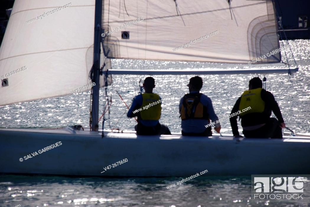 Stock Photo: Three people sailing on a sailboat in Valencia, Spain, Europe.