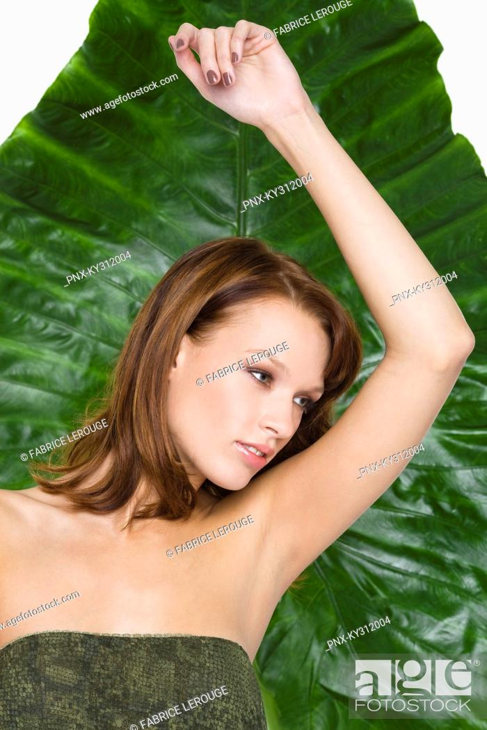 Stock Photo: Young woman with arm raised.