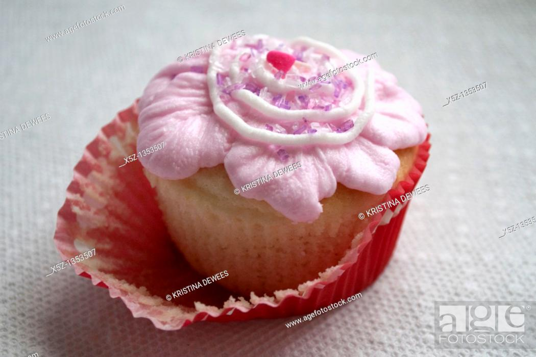 Stock Photo: A fancy frosted cupcake half unwrapped.