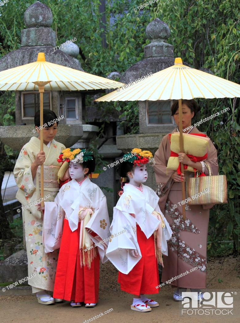 Stock Photo: Japan, Kyoto, Zuiki festival, mothers and daughters, Kitano Tenmangu Shrine, .