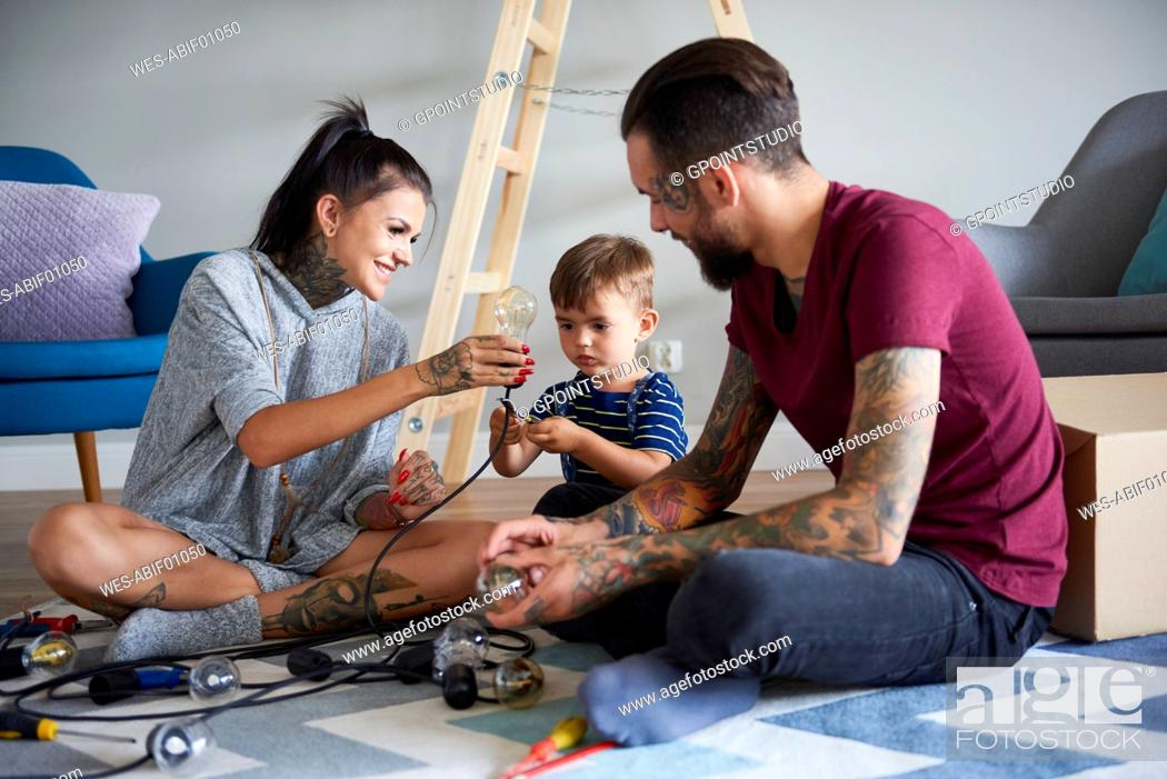 Stock Photo: Happy modern family decorating the home for Christmas.