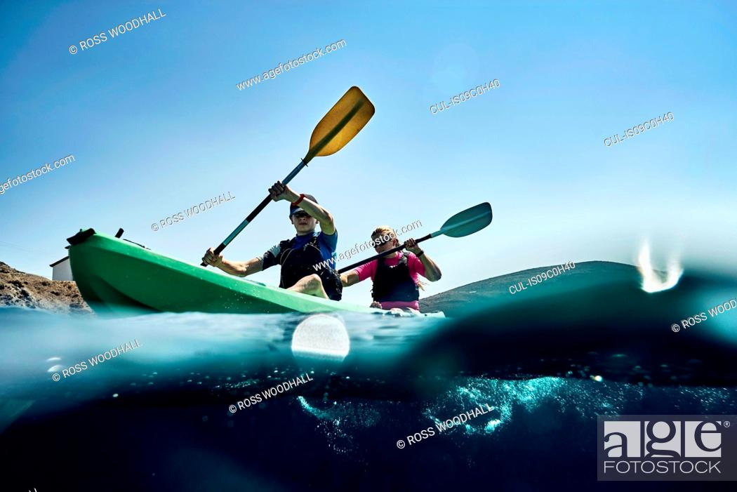 Stock Photo: Teenage boy and mother sea kayaking on ocean, surface level view, Limnos, Khios, Greece.
