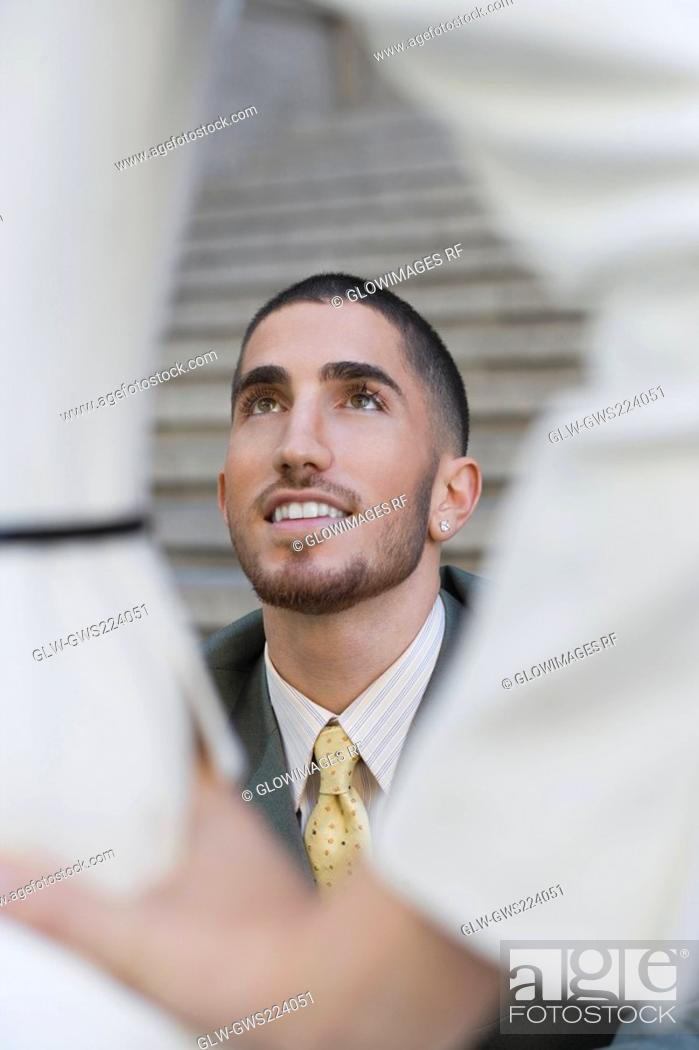 Stock Photo: Businessman smiling and looking up.