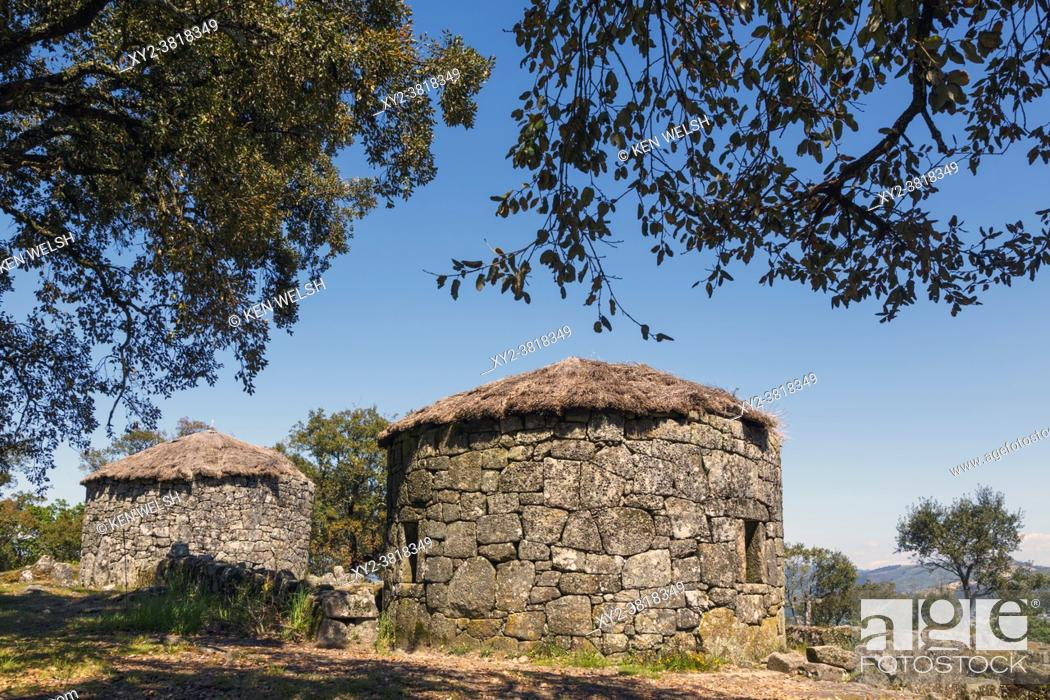 Stock Photo: Citania de Briteiros, Braga District, Portugal. Iron Age settlement. Two reconstructed stone houses. One of Portugal's most important archeological sites.