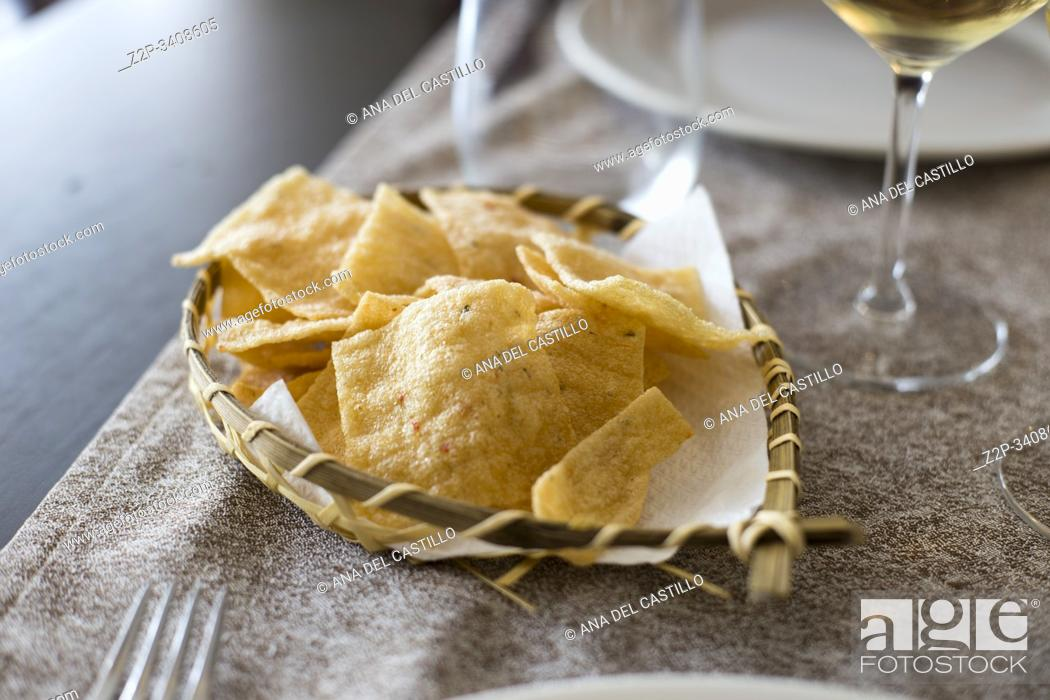 Stock Photo: Crispy snack with white wine on table.