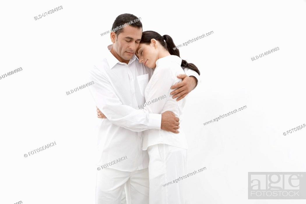 Stock Photo: Woman and man in white clothes hugging.