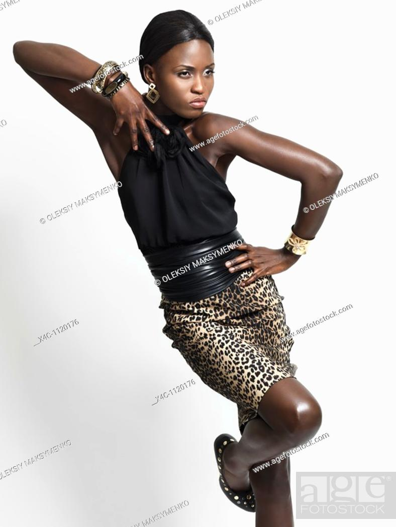 Stock Photo: Attractive young woman in trendy clothes  Isolated on white background  High fashion photo.