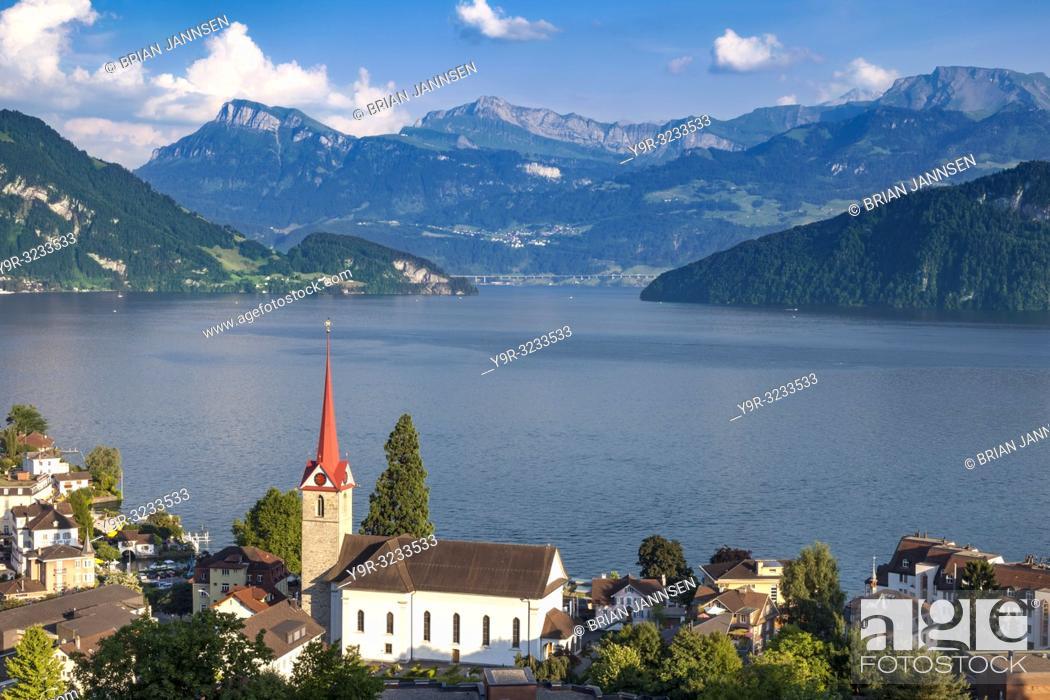 Stock Photo: Parish Church St. Maria and the village of Weggis overlooking Lake Lucerne, Switzerland.
