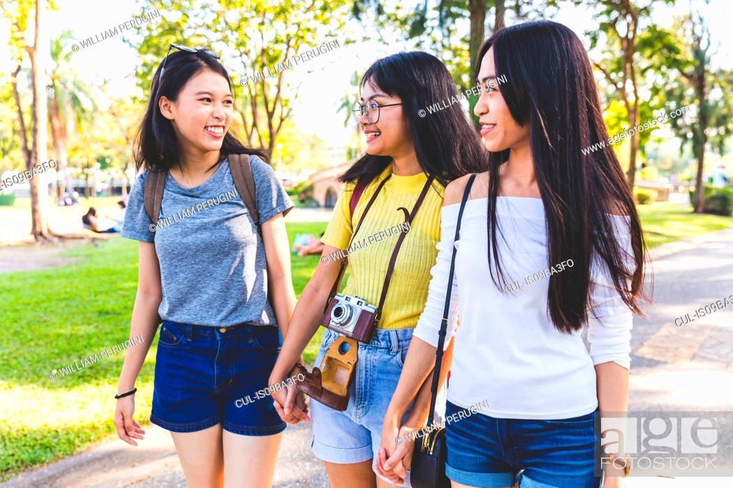 Stock Photo: Friends walking and sightseeing in park, Bangkok, Thailand.