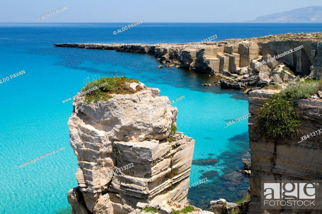 Stock Photo: Italy, Sicily, Favignana island, Cala Rossa, Tuff cliffs.