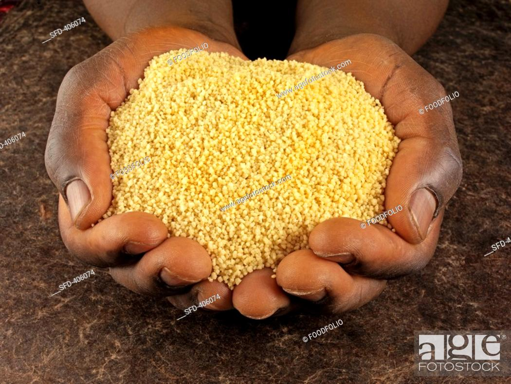 Stock Photo: Hands holding couscous.
