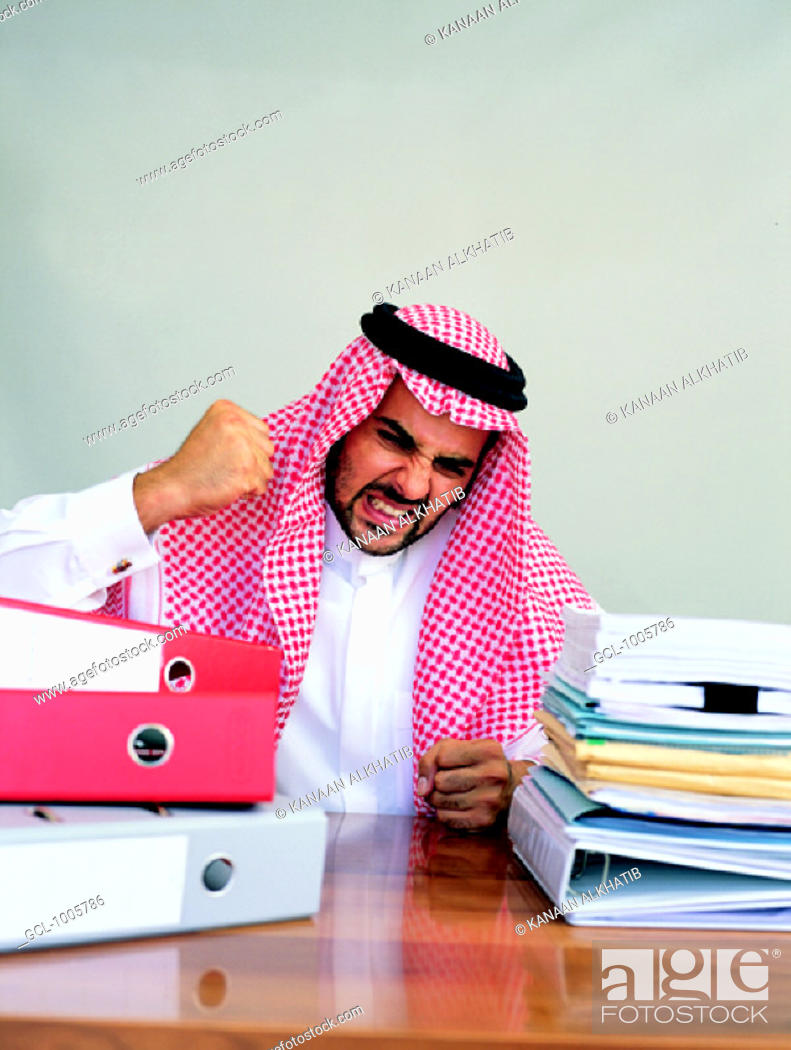 Stock Photo: Arab businessman being angry at his desk.