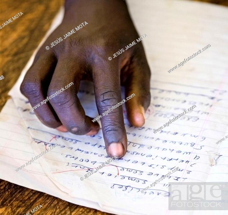 Stock Photo: Boy's hand at school. Ethiopia.