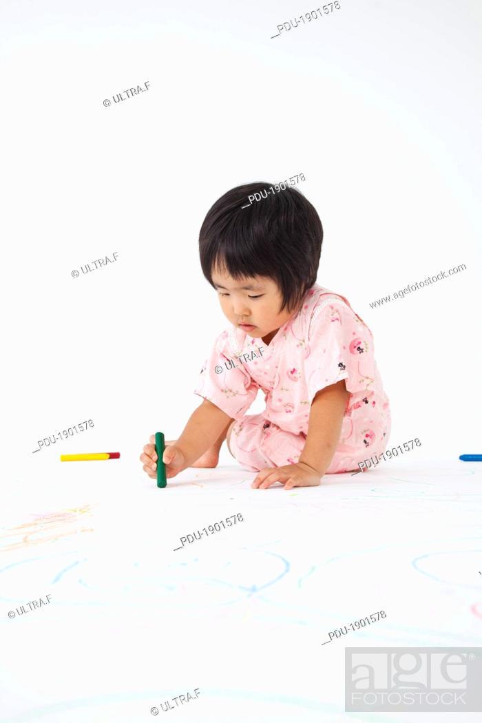 Stock Photo: Japanese girl scribbles,puts on the yukata.