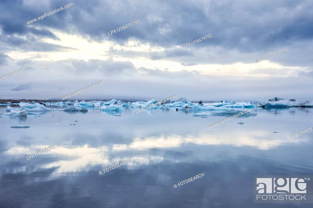 Stock Photo: Icebergs at Jokulsarlon lagoon sunrise, Iceland.