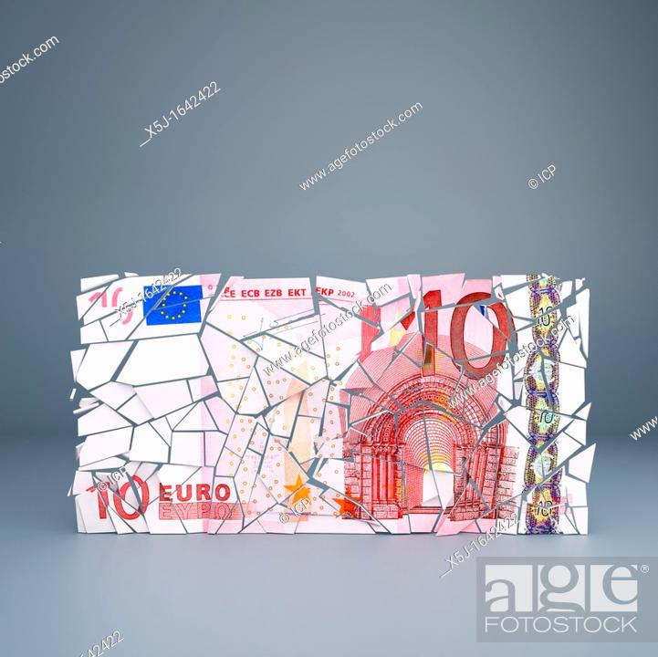 Stock Photo: Ten Euro note crumbling - representing the break up of the European Union single currency / default of Eurozone countries.