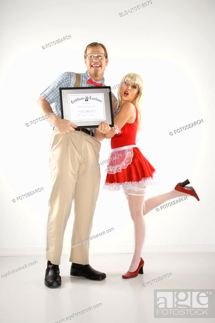 Stock Photo: Man dressed like nerd holding certificate with woman dressed in french maid outfit.