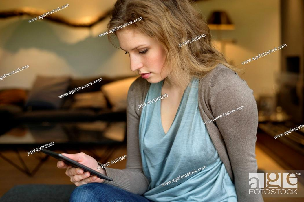 Stock Photo: Woman using digital tablet.