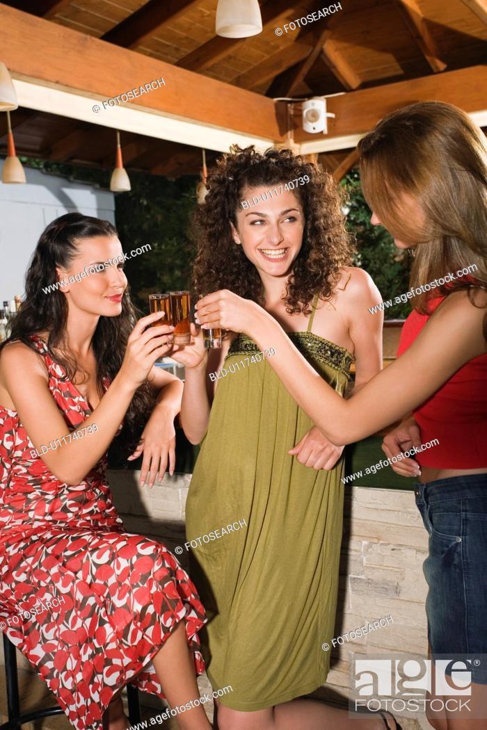 Stock Photo: Three women in a bar.