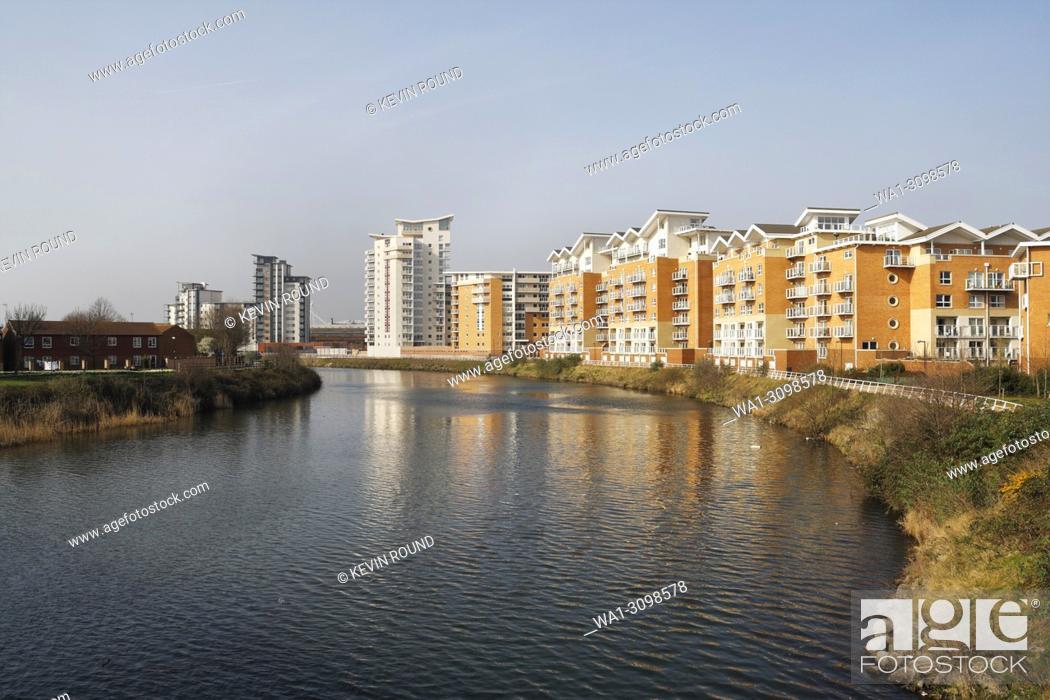 Stock Photo: Modern apartment blocks, River Taff in Cardiff, Wales UK.