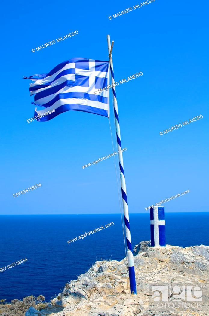Stock Photo: Flag and pylon with insignia of Greece, near Kastro on the island of Skiathos.