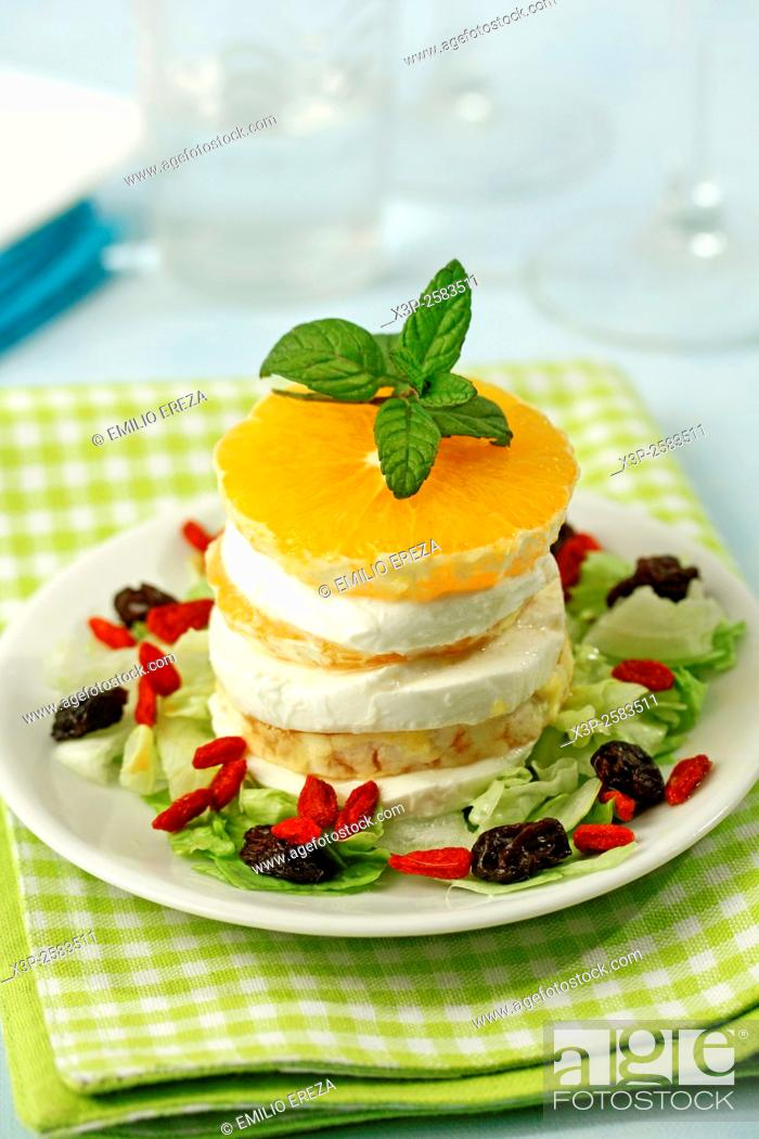 Stock Photo: Orange and mozzarella tower.