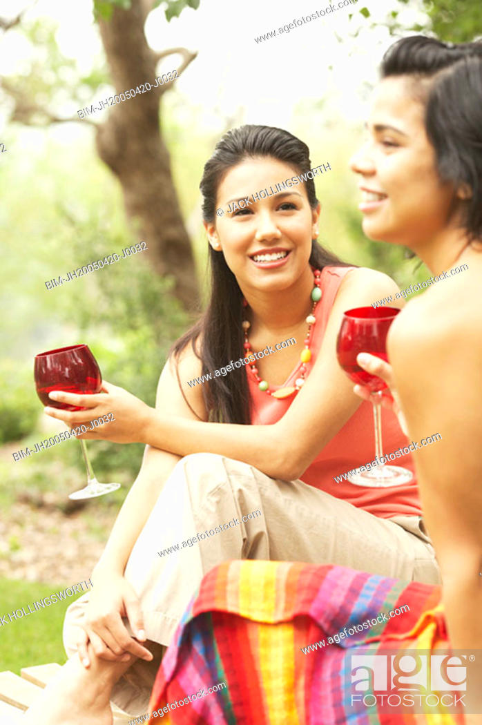 Stock Photo: Two young women holding glasses of wine.