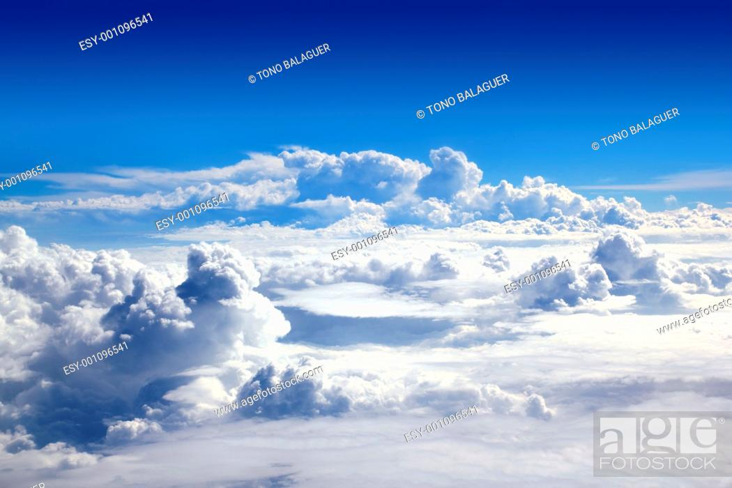 Stock Photo: blue sky high view from airplane clouds shapes.
