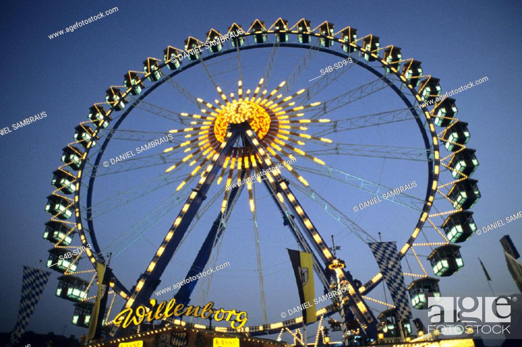 Stock Photo: Riesenrad auf einem Jahrmarkt - Fahrgeschaeft - Nacht , Ferry Wheel on a Funfair - Fairground Ride - Night ,  fully-released.