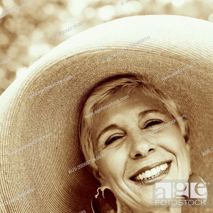 Stock Photo: Portrait of a senior woman smiling.