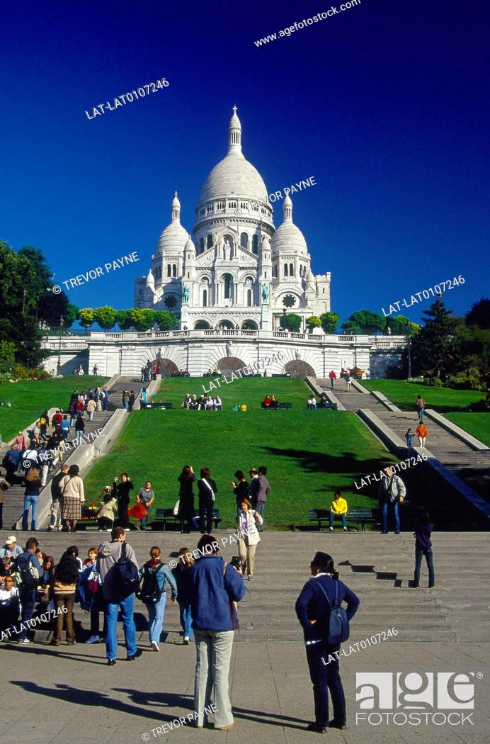 Stock Photo: Montmartre. Sacre Coeur basilica,church. White marble,domes. Blue sky. Steps. Crowd,people. Photographers.