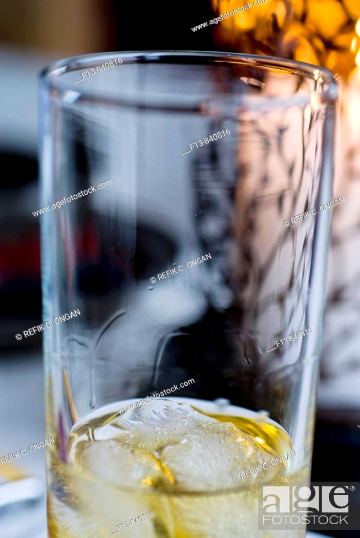 Stock Photo: ice and whisky in glass.