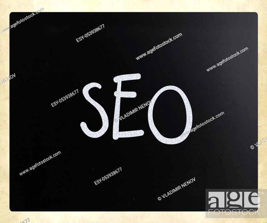 "Stock Photo: The word """"SEO"""" handwritten with white chalk on a blackboard."