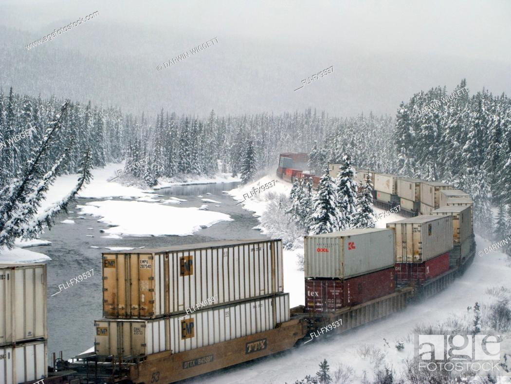 Stock Photo: Canadian Pacific train at Morant's Curve along the Bow River, Banff National Park, Alberta.