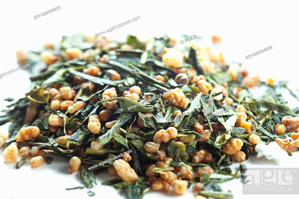 Stock Photo: Dried herbal tea leaves isolated over white background.