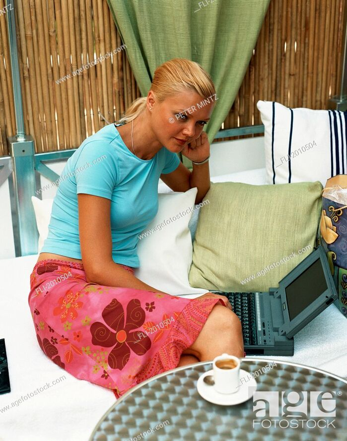 Stock Photo: Fv4028, Peter Mintz; Woman Having Coffee With Laptop.