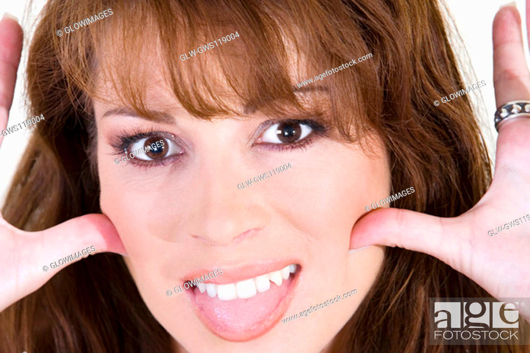 Stock Photo: Portrait of a young woman making a face.