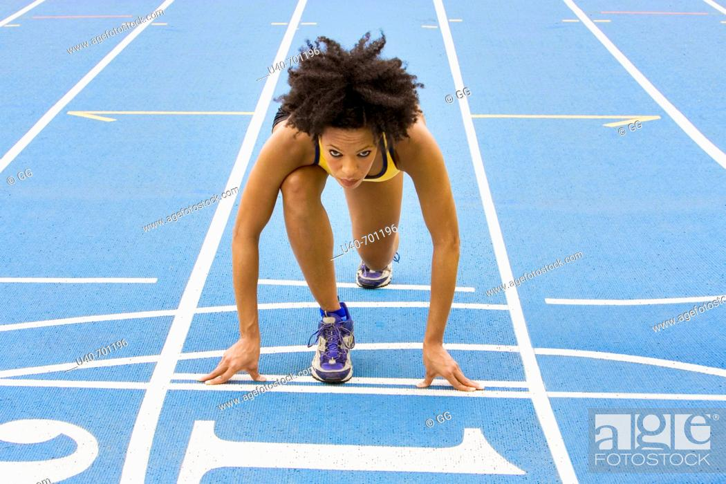 Stock Photo: African American woman running track.
