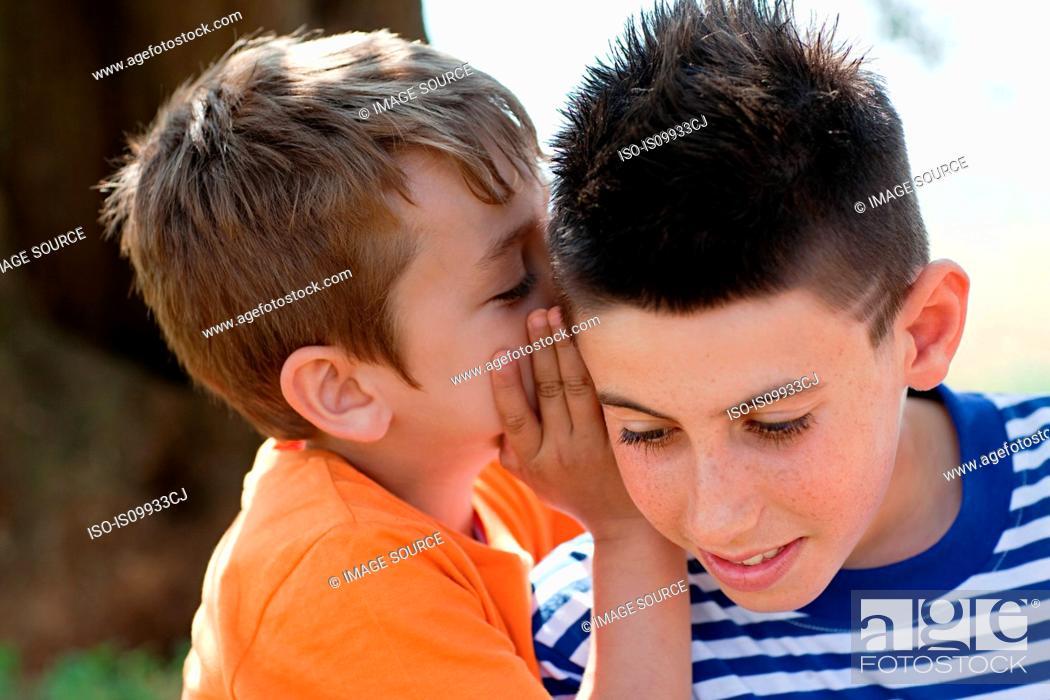 Stock Photo: Boy whispering to firiend.
