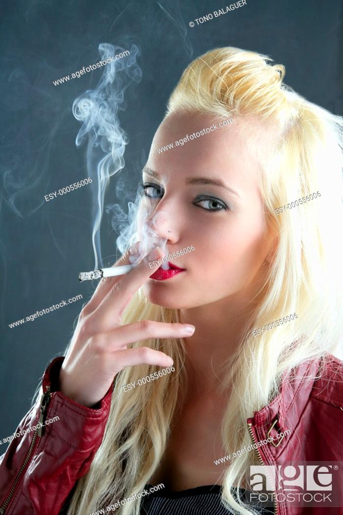 blonde smoking cigarette young fashion girl gray background ...