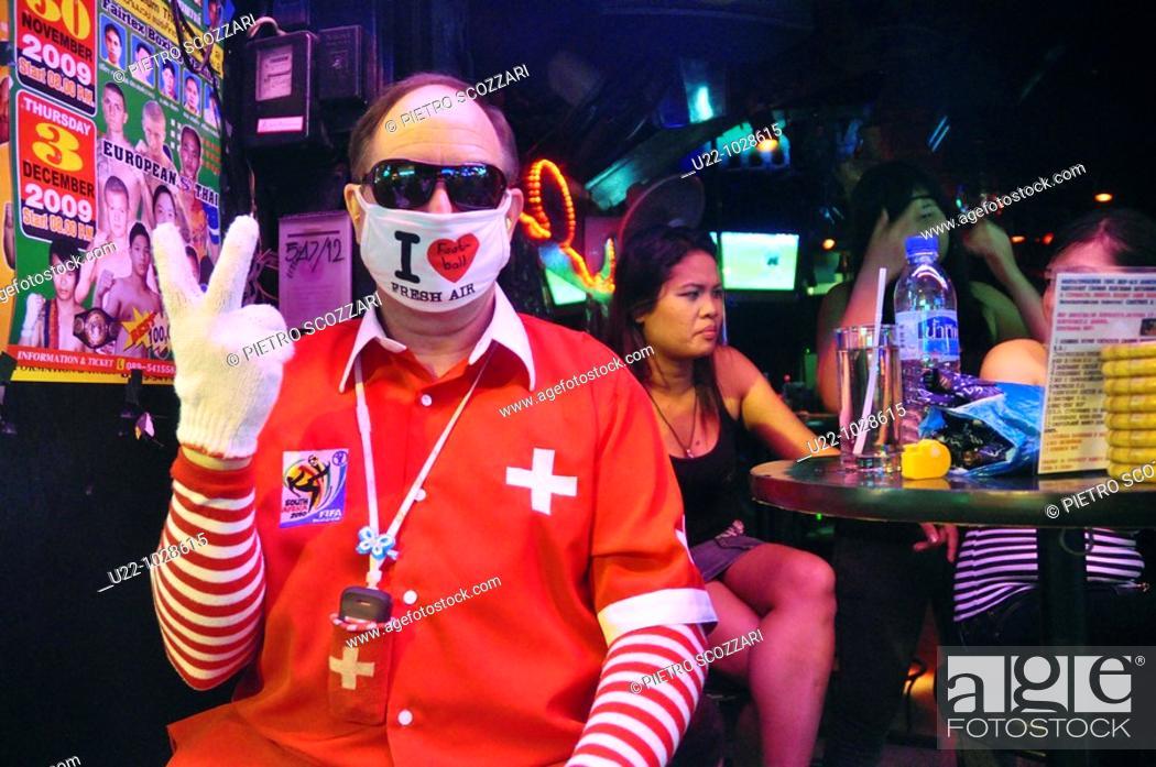 Stock Photo: Pattaya (Thailand): weird tourist at a bar along the Walking Street.