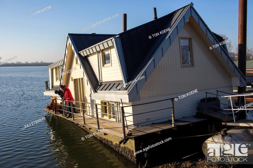 Stock Photo: Waterlevel of the river Maas dropped three meters due to an dysfunctional weir.